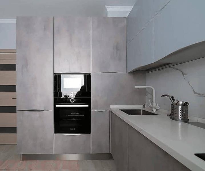 Дизайн угловой кухни в современном стиле минимализм под бетон